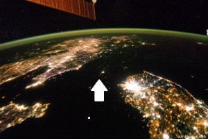 AP10ThingsToSee - This Jan. 30, 2014 photo made available by NASA on Monday, Feb. 24, 2014 shows North Korea, darker area at center, between South Korea, right, and China, left. Lights from the North Korean capital, Pyongyang, are visible at center. The image comparing the night time lights of the countries was made by the Expedition 38 crew aboard the International Space Station. (AP Photo/NASA, File)